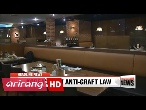 EARLY EDITION 18:00 Economic benefits assessed as anti-graft law takes effect