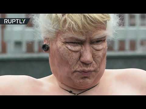 Активистка FEMEN в образе Трампа устроила акцию протеста возле посольства США в Киеве