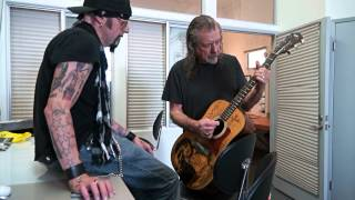 Robert Plant playing Elvis guitar at Christopher Ameruoso photo shoot