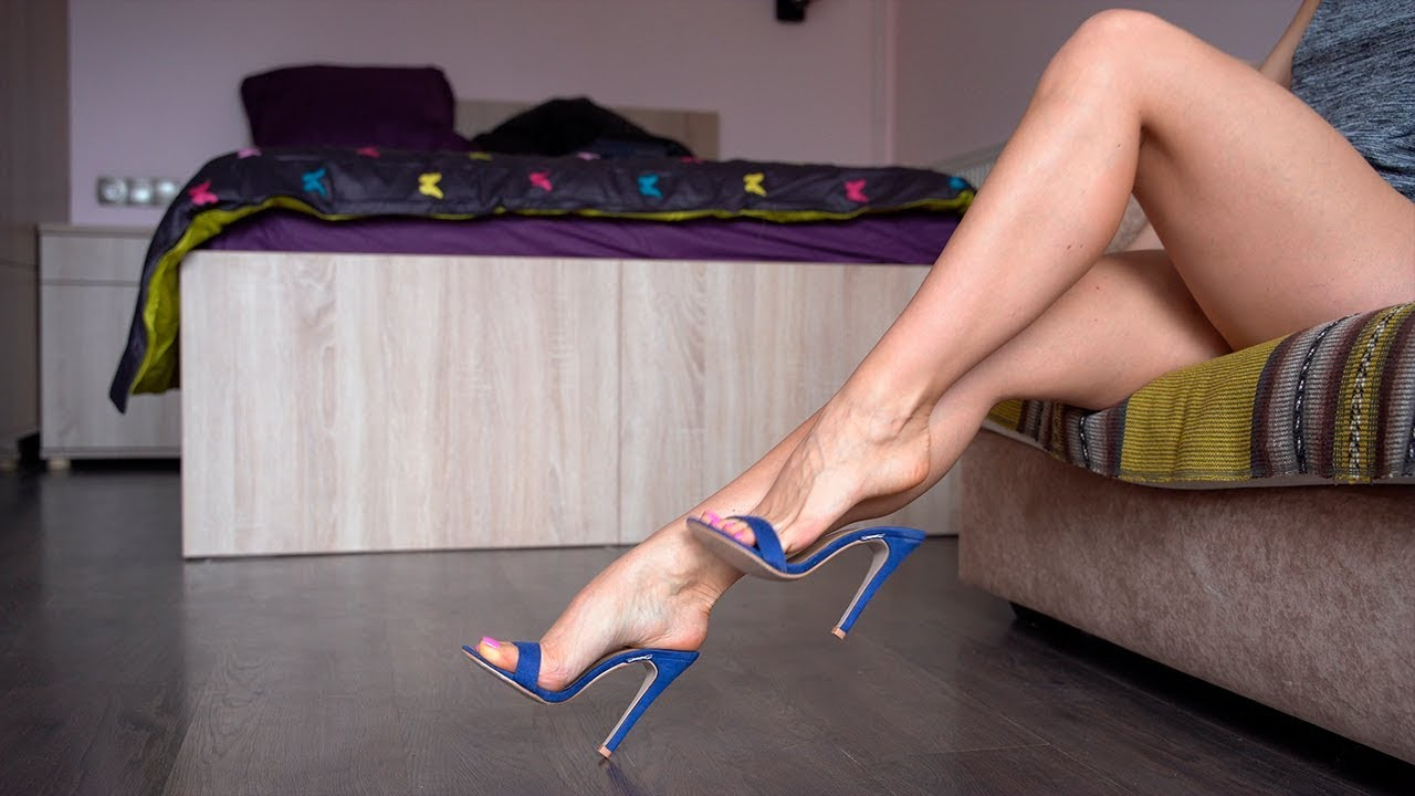 Girl shows her long legs and pretty feet in Blue Mules