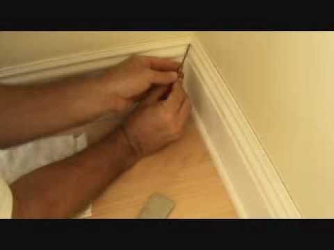 Installing baseboard: caulking an inside corner