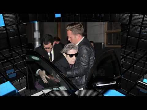 Frail Shane MacGowan carried out of wheelchair into car before drinking beer leaving U2