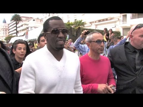 AMAZING  Sean Combs aka Diddy having a massive crowd bath while shopping in Cannes