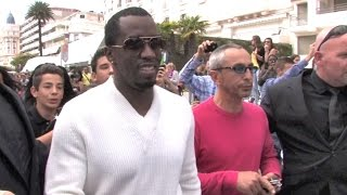 AMAZING ! Sean Combs aka Diddy having a massive crowd bath while shopping in Cannes