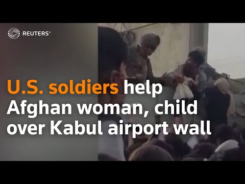 U.S. soldiers help Afghan woman, child over Kabul airport wall