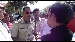 BJP Leader Fighting with DSP over Helmet