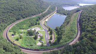 Awesome Drone Shot Of NS Loaded Coal Train At Horseshoe Curve In Altoona, PA 8-26-17