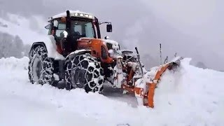 Fendt 820 in Orange Tractor beside the country road heavy snow wall