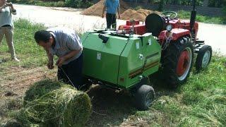 haying machines----disc mower, hay rakes, mini round baler, bale wrapper