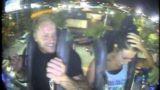 Girls boobs falls out of sling shot ride