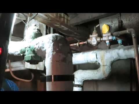 old-school-boiler-with-water-leaking-from-relief-valve-,loaded-with-asbestos