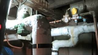old school boiler with water leaking from relief valve ,loaded with asbestos