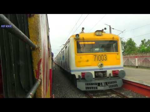Early morning Krishnagar local train entering Halisahar railway station with crossing other trains