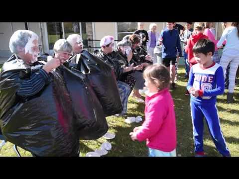 Queen of Apostles School staff get pies in the face
