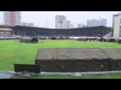 Hundreds stranded in Manila stadium fear virus