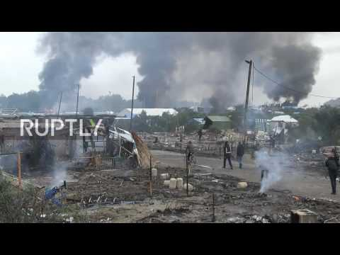 France: Fires continue raging as Calais refugee camp eviction enters third day