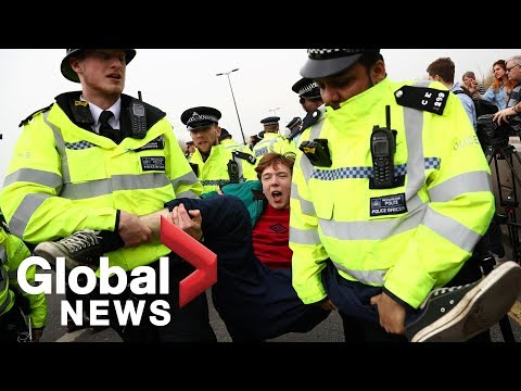 British police drag, arrest climate change activists blocking London's Waterloo bridge