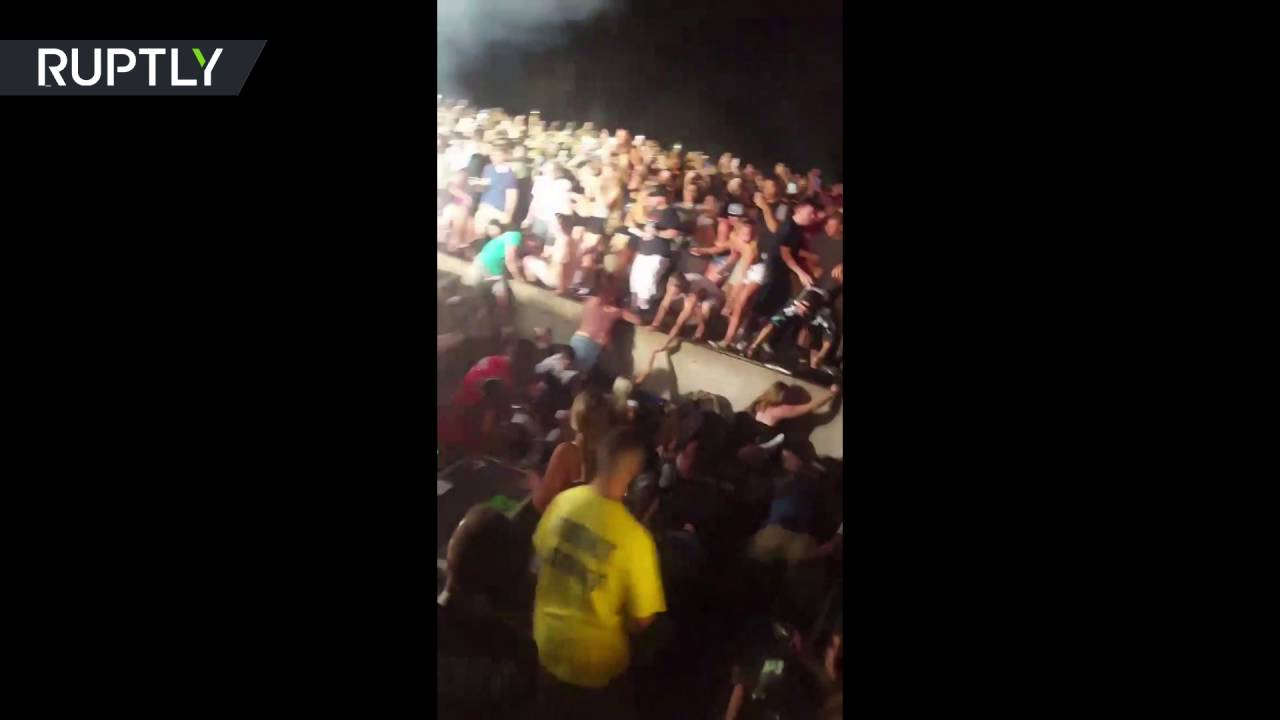 Moment railing collapses at Snoop Dogg and Wiz Khalifa concert, dozens injured