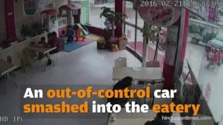 CCTV footage - Car crashes into visitors at China burger shop
