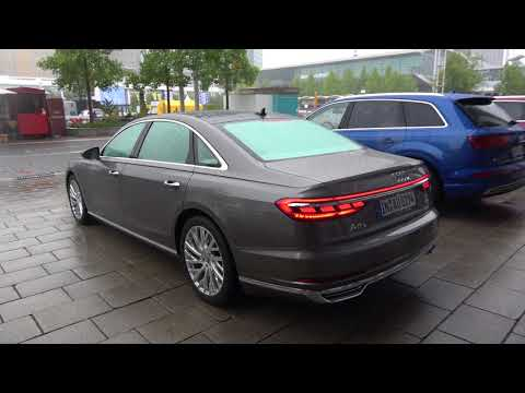 New Audi A8 in the rain has advanced OLED rearlights :) Looks nice!
