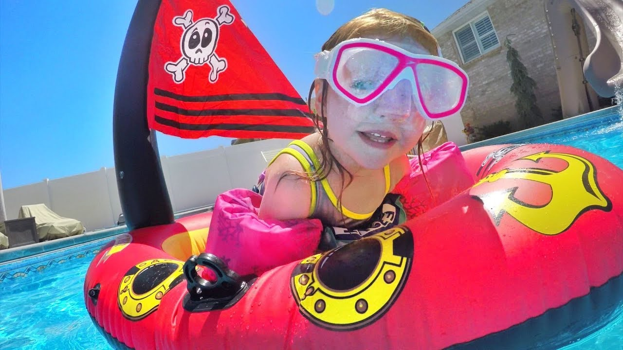 Download PIRATE SHIP POOL PARTY!! The family plays with inflatable toys and Adley is a mermaid!