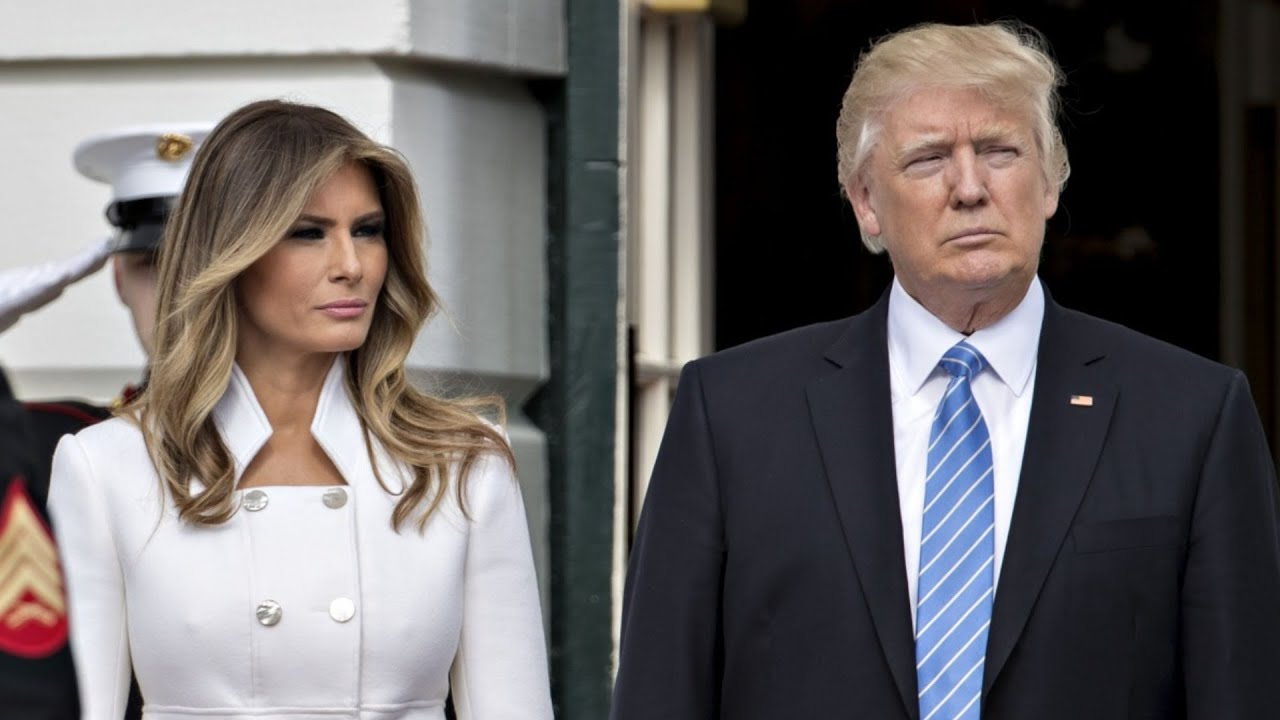 Download The Real Reason Melania Trump Swatted Donald Trump's Hand Away