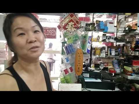 Newspaper grocery bags at Lee Mini Mart, Penang