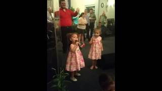 Little girl sings every praise!