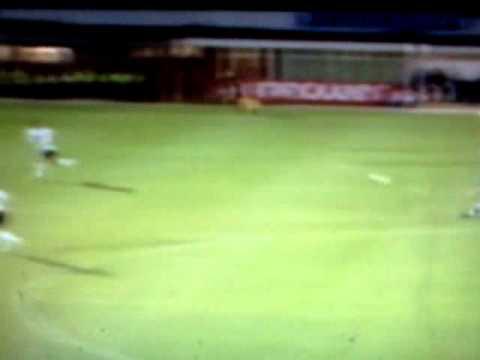 Macclesfield midfielder Ross Draper scores from halfway line