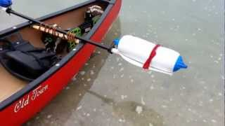 How to make a canoe outrigger system from boat fenders and a paddle