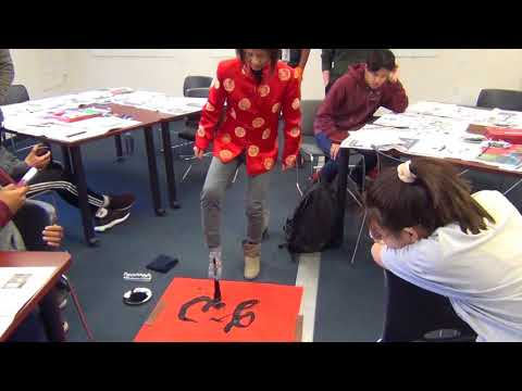 "Chinese Calligraphy Demo at WEBB Schools Victoria wrote a large ""dog"" with her foot"