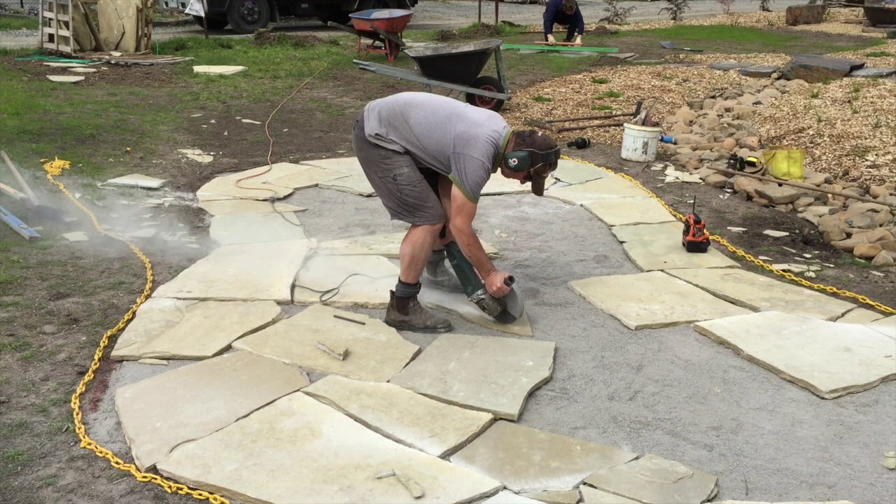 How To Cut Stone Pavers Using An Angle Grinder - How To Cut Stone Pavers Using An Angle Grinder - YouTube