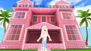 BUYING A HUGE PINK MANSION IN ROBLOX! 100,000 COIN SPENDING SPREE!