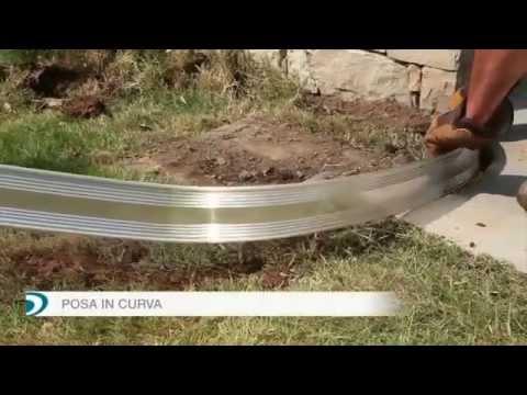 Come realizzare unaiuola curvilinea con ciottoli e bordura in