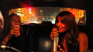Michaela and Ida singing in the cab