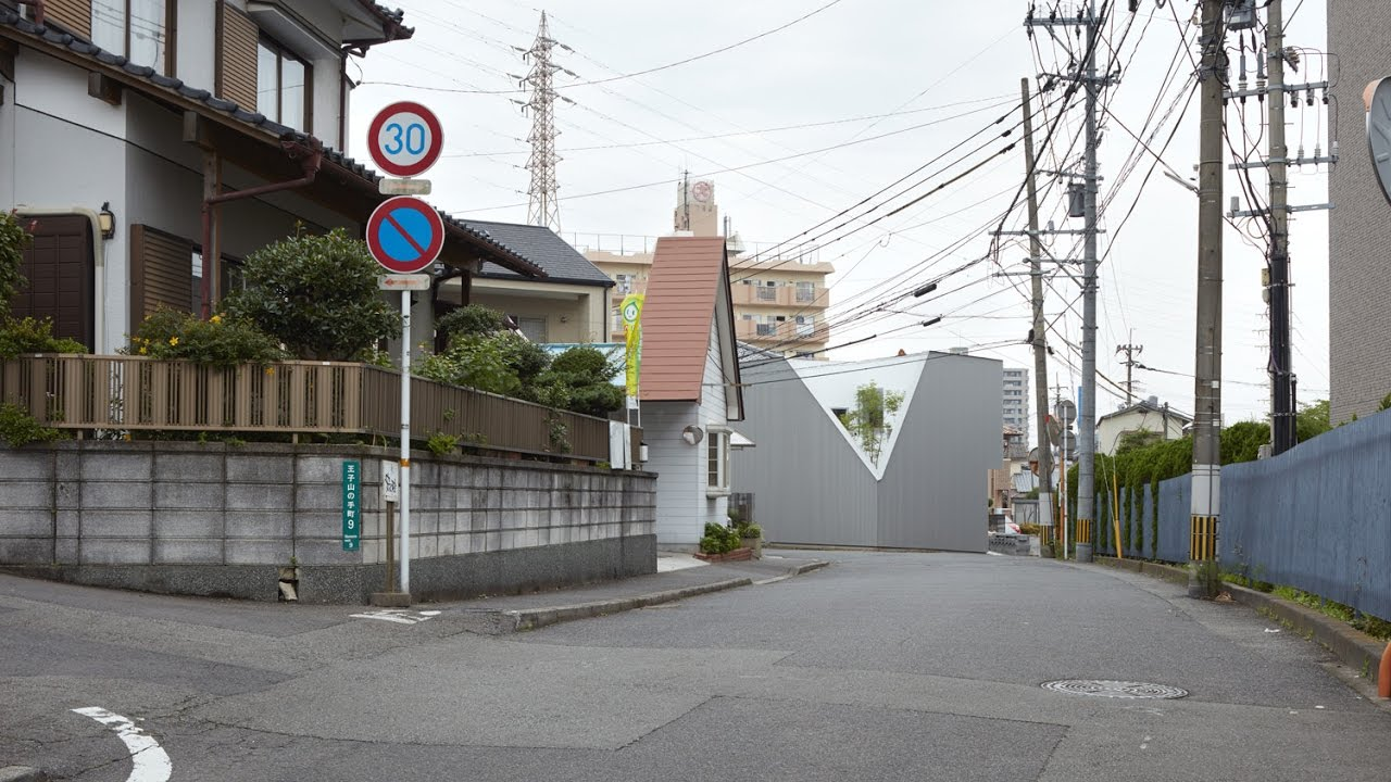 Corner Lot House Design Idea with Minimalist Exterior Appearance ...
