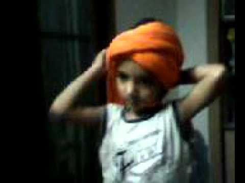 A junior sikh tying Turban