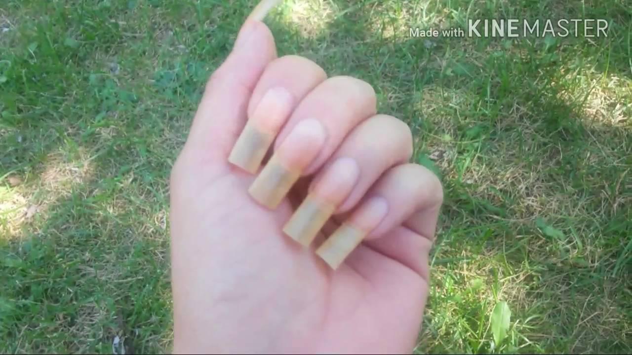 showing long natural nails unpolished