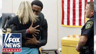 Botham Jean's brother forgives, hugs convicted murderer Amber Guyger