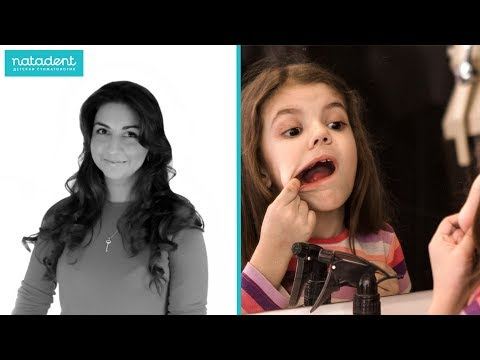 Шишка на десне у ребенка над зубом не болит фото