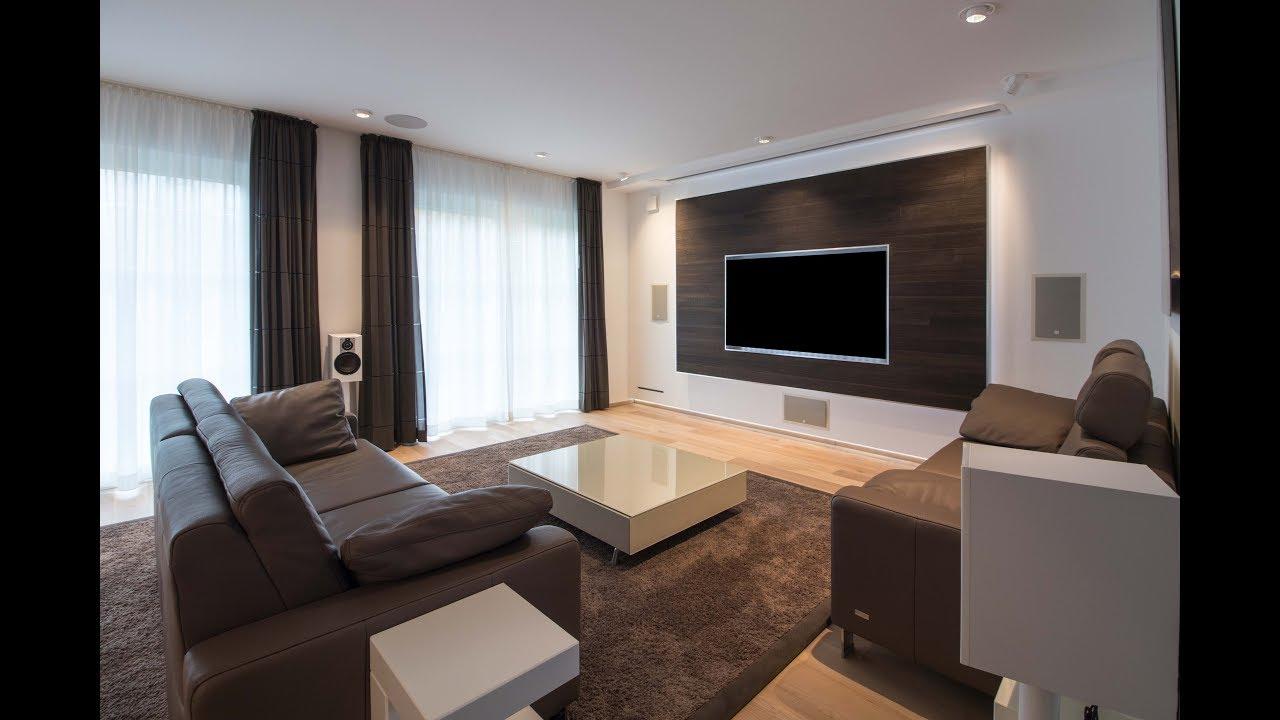 Heimkino integrale wohnraum kino mit tv und projektion made by