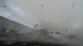 Тайфун поднял в воздух автомобиль