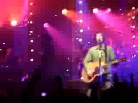 Liam Gallagher helping Richard Ashcroft on stage