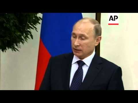 Russian President Putin gives briefing after meeting Hollande; comments on Ukraine