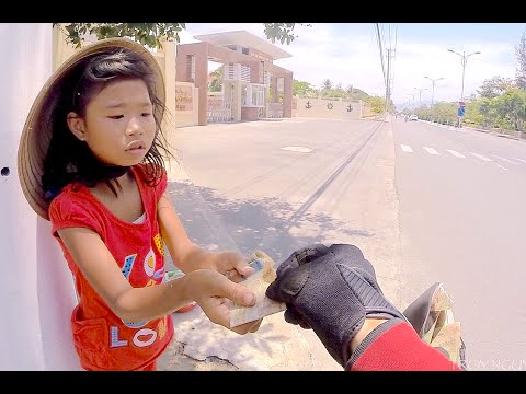 Buying water for a poor girl in Nha Trang. Vietnam.