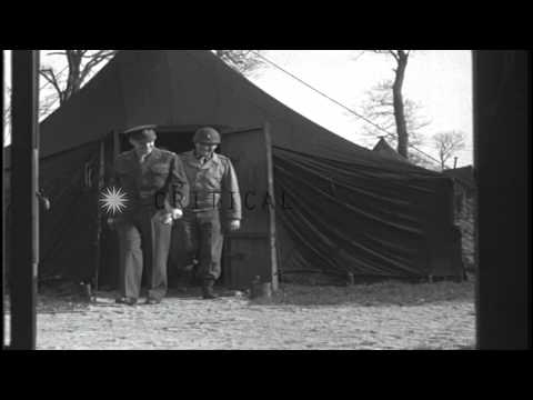 General Eisenhower visits camps and an ordnance depot in Cherbourg, France during...HD Stock Footage