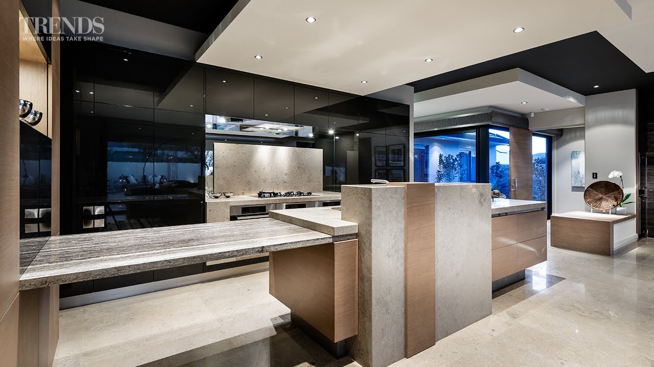 Galley Kitchen Design Merges With Large Living Space And