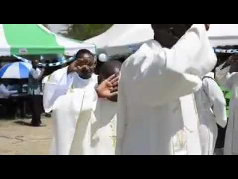 Catholic priests dancing