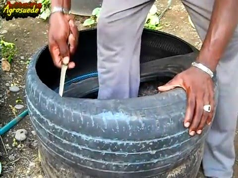 How to cut a tire to make a garden raised bed pots for How to make a tire garden