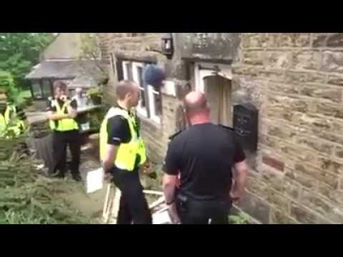 UK Court Enforcement Officers Struggle to Break Down Door To Reposess House